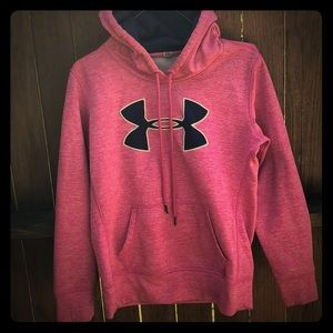 Bright pink Under Armour sweatshirt.